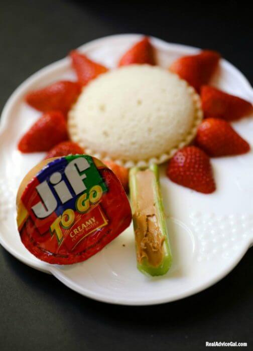 Stay at home vacation snack with Uncrustables® Sandwiches, Jif® to Go® Peanut Butter and Smucker's® Squeeze™ Fruit Spread