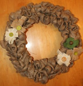 burlap wreath finished and decorated with burlap flowers