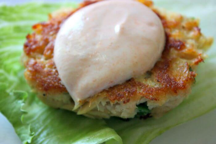 Tasty low calorie tuna cakes recipe with green onions, bread crumbs, old bay seasoning and egg whites. Serve with lettuce wrap.