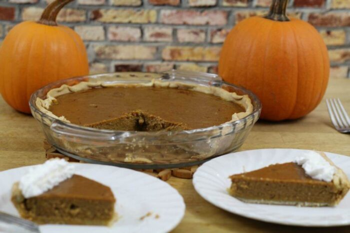 https://madamedeals.com/wp-content/uploads/2015/11/A-slice-of-low-calorie-pumpkin-pie-with-just-a-touch-of-whipped-cream-is-the-perfect-dessert-for-me.jpg