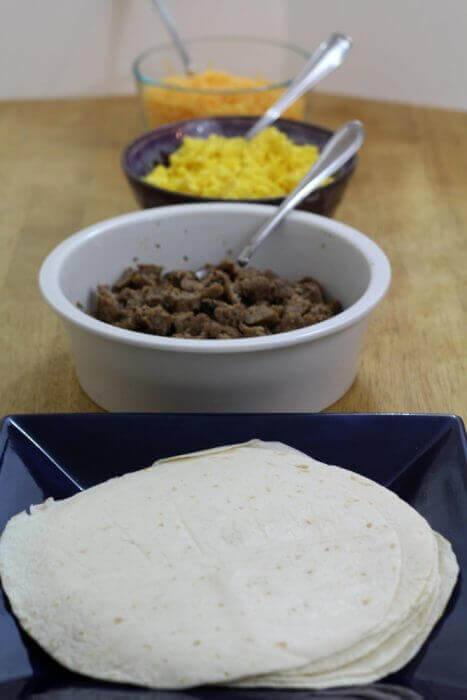 Sausage Egg and cheese breakfast burritos recipe assembly line