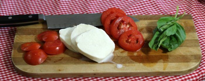 Tomato Mozzarella Caprese Salad is made with fresh ingredients including tomatoes, mozzarella, and basil