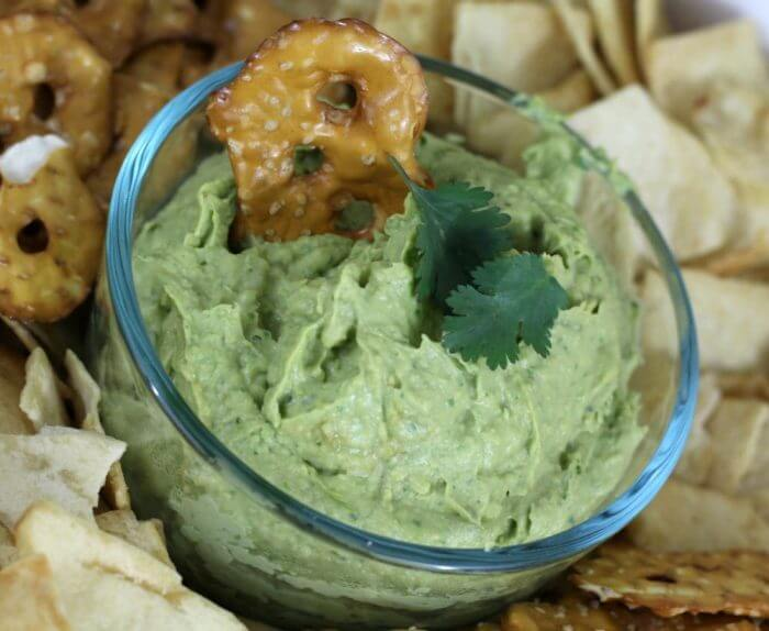 Avocado Cilantro Hummus is great with pita chips and pretzel thins