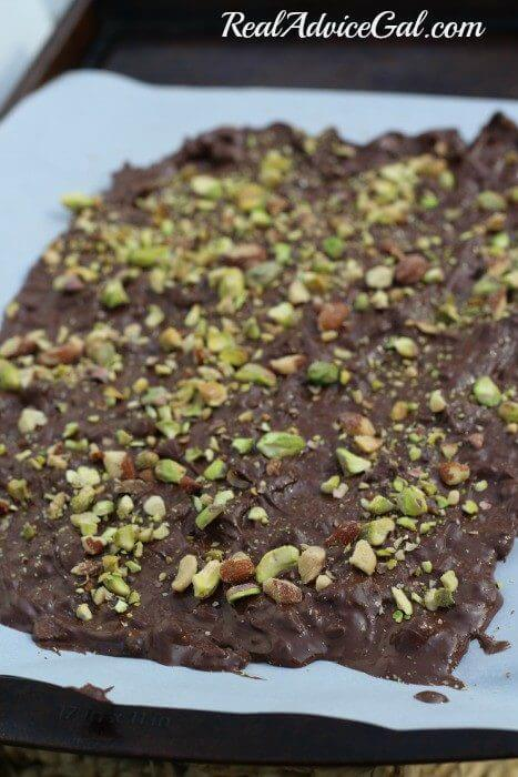Salted Almond and Pistachio Bark Spread on a cookie sheet