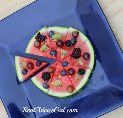 Use a pizza slicer to cut the watermelon fruit pizza into slices