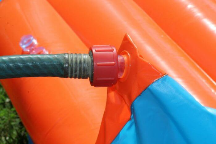 Attach the hose to the water slide