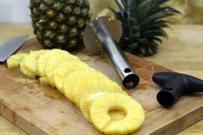 Remove the pineapple from the corer