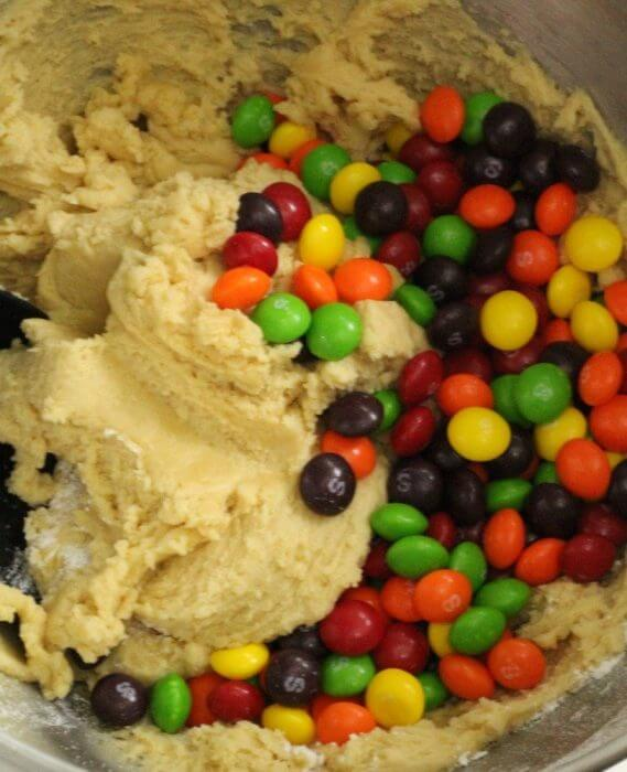 Mix the skittles into the sugar cookie dough